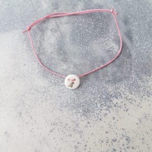 armband dino rosa
